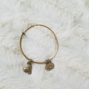 Gold Alex and Ani charm bracelet
